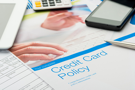 Credit card policy document with paperwork