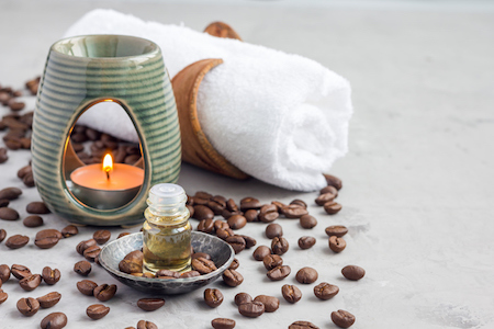 Aroma lamp with coffee essential oil, spa background, horizontal